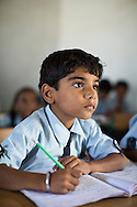 Hemant Jat, aged 6, studies in class in the Vasudha Vidya Vihar school in Khargone, Madhya Pradesh, India on 12 November 2014. Hemant is the son of a Fairtrade Cotton Producer and his ambition is to be a Police Officer. Fairtrade farmers get a 5% discount on school fees because the school was built using the Fairtrade Premium. Photo by Suzanne Lee for Fairtrade