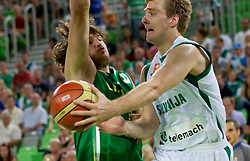 Simas Jasaitis of Lithuania vs Zoran Dragic of Slovenia during friendly match before Eurobasket Lithuania 2011 between National teams of Slovenia and Lithuania, on August 24, 2011, in Arena Stozice, Ljubljana, Slovenia. (Photo by Vid Ponikvar / Sportida)