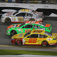 Race car drivers Joey Logano (22), Danica Patrick (10) and Dale Earnhardt Jr. (88) race during the NASCAR Sprint Unlimited Race at Daytona International Speedway on Saturday, February 15,  2014 in Daytona Beach, Florida.  (AP Photo/Alex Menendez)