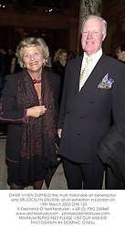 DAME VIVIEN DUFFIELD the multi millionaire art benefactor and SIR JOCELYN STEVENS, at an exhibition in London on 19th March 2002.OYK 123