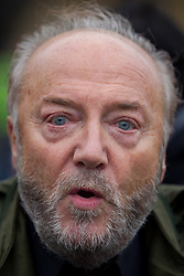 © Licensed to London News Pictures . 12/10/2013 . Bradford , UK . George Galloway MP , Respect Party Member of Parliament for Bradford West , at a counter protest in Bradford's Peace Gardens , during the EDL demonstration . The EDL hold a demonstration in Bradford today (Saturday 12th October 2013) . It is their first demonstration since leaders Stephen Yaxley-Lennon (aka Tommy Robinson ) and Kevin Carroll quit . Approximately 500 protesters gathered near the city centre . Photo credit : Joel Goodman/LNP