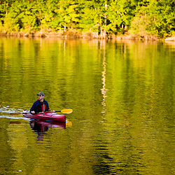 A man kayaks on Lake Francis in Pittsburg, New Hampshire.
