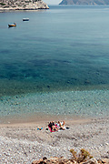 Greece, Amorgos island, relaxing on the beach