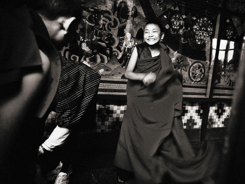 Asia, Bhutan, Paro, Dzong, young monk in warm light, colors, bw