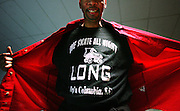"Charles Davis wears his ""We Skate All Nigh Long"" t-shirt at Red Wing Roller Derby, Sunday, January 20, 2007. Davis says there is a large group that travels to a monthly skate party once a month. They go to rinks in Atlanta, Charlotte, and multiple spots in Florida"
