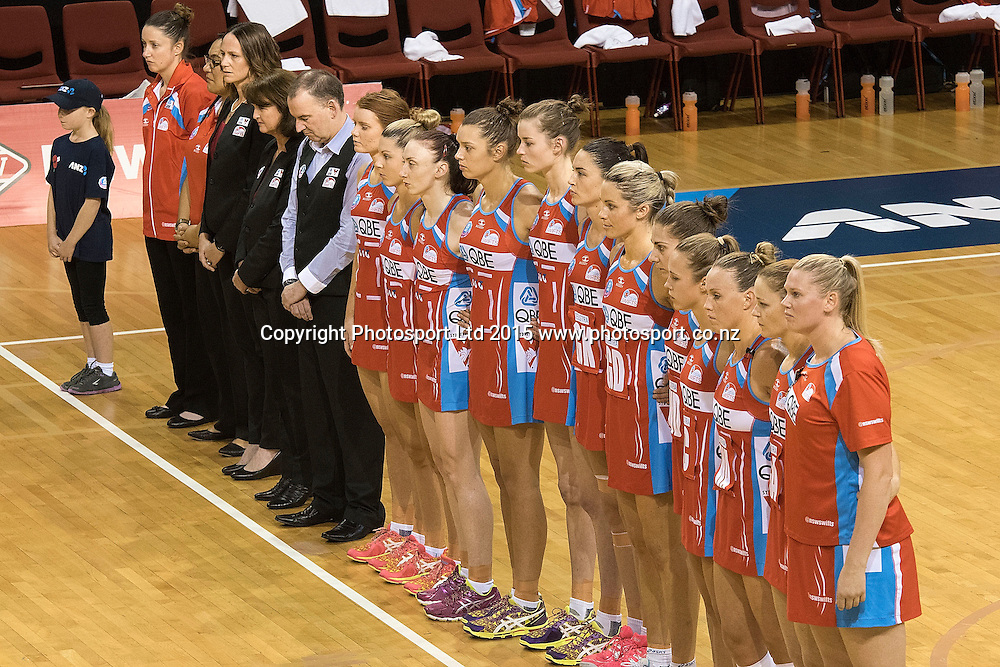 The Swifts stand as the last post is played as netball remembers ANZAC Day during the ANZ Championship - Pulse v Swifts netball match at the TSB Arena in Wellington on Saturday the 25th of April 2015. Photo by Marty Melville / www.Photosport.co.nz