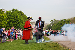 Windsor, UK. 22nd April 2019. John Matthews, borough bombardier, supervises Cllr Paul Lion, Mayor of Windsor and Maidenhead, in firing a small cannon as part of a traditional 21-gun salute on the Long Walk in front of Windsor Castle for the Queen's 93rd birthday. The Queen's official birthday is celebrated on 11th June.