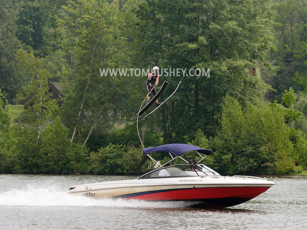 Monroe, NY- A water ski jumper flies through the air while being pulled by a boat during a competition at Twins Lakes Water Ski Park on July 28, 2008.
