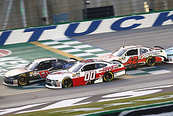 July 13, 2018 - Sparta, Kentucky, United States of America - Ty Majeski (60), Cole Custer (00) and John Hunter Nemechek (42) battle for position during the Alsco 300 at Kentucky Speedway in Sparta, Kentucky. (Credit Image: © Chris Owens Asp Inc/ASP via ZUMA Wire)