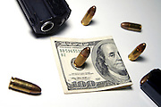 Weapons and money the two ingredients for power and greed on white background