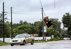 A traffic light dangles precariously at the intersection of Winter Lake Road and Thornhill Road in Polk County on Monday, Sept. 11, 2017 after Hurricane Irma plowed through Central Florida. Photo by Orlando Sentinel/TNS/ABACAPRESS.COM
