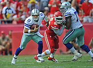KANSAS CITY, MO - SEPTEMBER 15:  Quarterback Tony Romo #9 of the Dallas Cowboys rushes up field past linebacker Tamba Hali #91 of the Kansas City Chiefs during the second half on September 15, 2013 at Arrowhead Stadium in Kansas City, Missouri.  Kansas City defeated Dallas 17-16. (Photo by Peter Aiken/Getty Images) *** Local Caption *** Tony Romo;Tamba Hali
