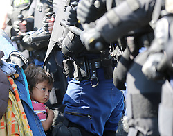 © London News Pictures. A young migrant girl is seen close to the Hungarian and Serbian border town of Roszke, Hungary, September 8 2015. The UN's humanitarian agencies are on the verge of bankruptcy and unable to meet the basic needs of millions of people because of the size of the refugee crisis in the Middle East, Africa and Europe, senior figures within the UN have told the media.   Picture by Paul Hackett /LNP
