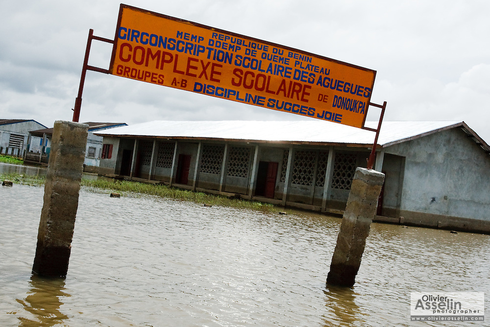The gateway to the flooded yard of the Donoukpa is seen in the town of Sahouicomey, Benin on Sunday October 24, 2010. The village, which is normally subject to seasonal flooding, has been severely hit by exceptional increases in water levels that have destroyed many houses and killed five people.