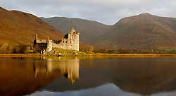 Kilchurn Castle, situated on a rocky peninsula at the northeastern end of Loch Awe was built in the mid-15th century as the base of the Campbells of Glenorchy. Seen here the castle is bathed in the early morning light of an autumnal sunrise... (c) Stephen Lawson | Edinburgh Elite media