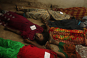 Dead bodies of garment workers lie down on the floor of morgue in Gazipur Shadar Hospital. They remain huddled together  even in the death they had been in life. 21 garment workers died in a fire broke out in Garib and Garib garment at Gazipur. 26th February 2010, Gazipur, Bangladesh
