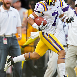 November 25, 2011; Baton Rouge, LA, USA; LSU Tigers cornerback Tyrann Mathieu (7) returns a punt for a touchdown during the second quarter of a game against the Arkansas Razorbacks at Tiger Stadium.  Mandatory Credit: Derick E. Hingle-US PRESSWIRE
