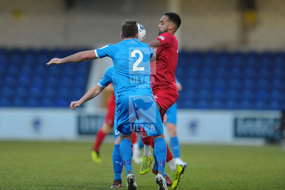 TELFORD COPYRIGHT MIKE SHERIDAN Brendon Daniels of Telford battles for the ball with Kevin Roberts during the Vanarama Conference North fixture between AFC Telford United and Chester at the 1885 Arena Deva Stadium on Saturday, December 21, 2019.<br /> <br /> Picture credit: Mike Sheridan/Ultrapress<br /> <br /> MS201920-035