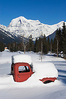 Abandoned 1950's era red truck covered in snow, Mount Robson Provincial Park British Columbia Canada
