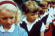 Miserable school children lining up in the playground, Private School, UK 2000's