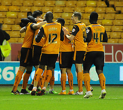 Wolves players mob Danny Batth following his opening goal against Fulham - Photo mandatory by-line: Paul Knight/JMP - Mobile: 07966 386802 - 24/02/2015 - SPORT - Football - Wolverhampton - Molineux Stadium - Wolverhampton Wanderers v Fulham - Sky Bet Championship
