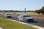 Chaz Mostert & Cameron Waters leading Mark Winterbottom & Steve Owen  (Pepsi Max Ford). 2015 Wilson Security Sandown 500. V8 Supercars Championship Round 9. Sandown International Raceway, Victoria. Sunday 13 September 2015. Photo: Clay Cross / photosport.nz