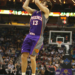 Feb 01, 2010; New Orleans, LA, USA; Phoenix Suns guard Steve Nash (13) shoots against the New Orleans Hornets during the first half at the New Orleans Arena. Mandatory Credit: Derick E. Hingle-US PRESSWIRE