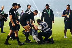 New Zealand replacement Sonny Bill Williams helps up a young boy who is tackled by security after New Zealand win the match 34-17 to become 2015 World Cup Champions. He later give the boy his World Cup Winners Medal - Mandatory byline: Rogan Thomson/JMP - 07966 386802 - 31/10/2015 - RUGBY UNION - Twickenham Stadium - London, England - New Zealand v Australia - Rugby World Cup 2015 FINAL.