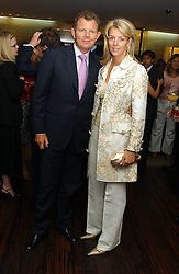 MISS FIONA SLEEMAN and MR BERNARD DREESMAN at a party to celebrate the publication of 'The Russian House' by Ella Krasner held at De Beers, 50 Old Bond Street, London W1 on 9th June 2005.<br />