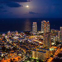 Aerial view of Miami Beach Southpoint waterfront at twilight with full moon rise.