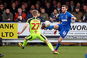 AFC Wimbledon attacker Adam Roscrow (10) controlling the ball and taking on Bolton Wanderers midfielder Ronan Darcy (27) during the EFL Sky Bet League 1 match between AFC Wimbledon and Bolton Wanderers at the Cherry Red Records Stadium, Kingston, England on 7 March 2020.