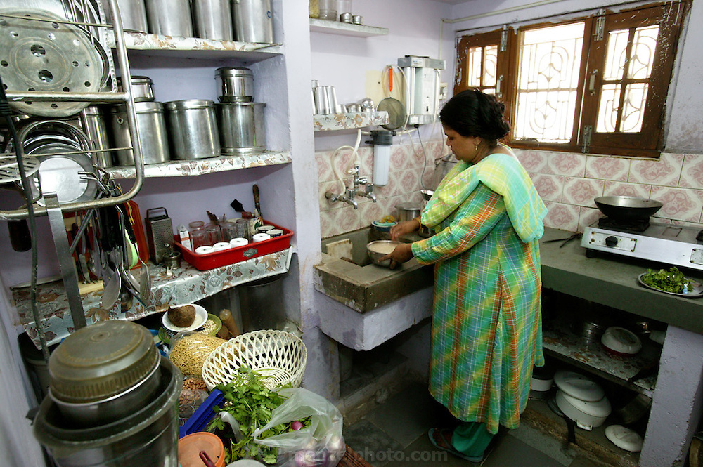 (MODEL RELEASED IMAGE). Sangeeta Patkar prepares a breakfast of poha (rice flakes) in her small, carefully organized kitchen. Hungry Planet: What the World Eats (p. 173). The Patkar family of Ujjain, Madhya Pradesh, India, is one of the thirty families featured, with a weeks' worth of food, in the book Hungry Planet: What the World Eats.