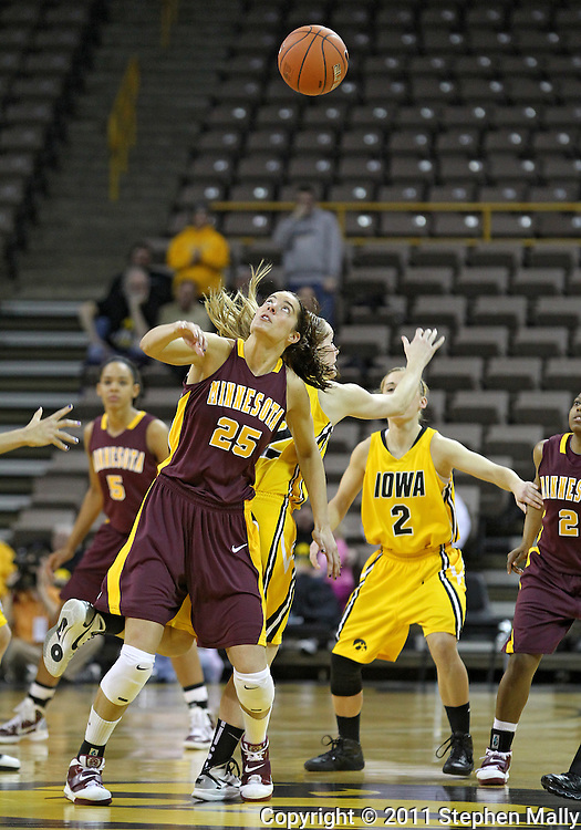 February 10 2011: Minnesota Golden Gophers forward Katie Loberg (25) looks up at the ball following the opening tipoff during the first half of an NCAA women's college basketball game at Carver-Hawkeye Arena in Iowa City, Iowa on February 10, 2011. Iowa defeated Minnesota 64-62.