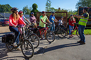 A tour guide gives a talk about electric bikes to a group of people who will be taking the bikes on a tour from the UK Electric Bike Centre, Staplehurst, Kent, England, UK.  (photo by Andrew Aitchison / In pictures via Getty Images)