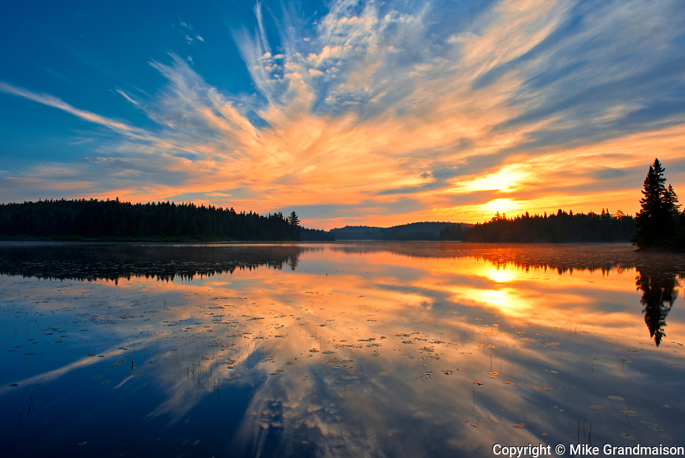 Reflection of clouds in Lac du Fou at sunrise<br />La Mauricie National Park<br />Quebec<br />Canada