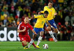 Korea's Jong Tae Se vs Brazil's Michel Bastos during the 2010 FIFA World Cup South Africa Group G match between Brazil and North Korea at Ellis Park Stadium on June 15, 2010 in Johannesburg, South Africa.  (Photo by Vid Ponikvar / Sportida)