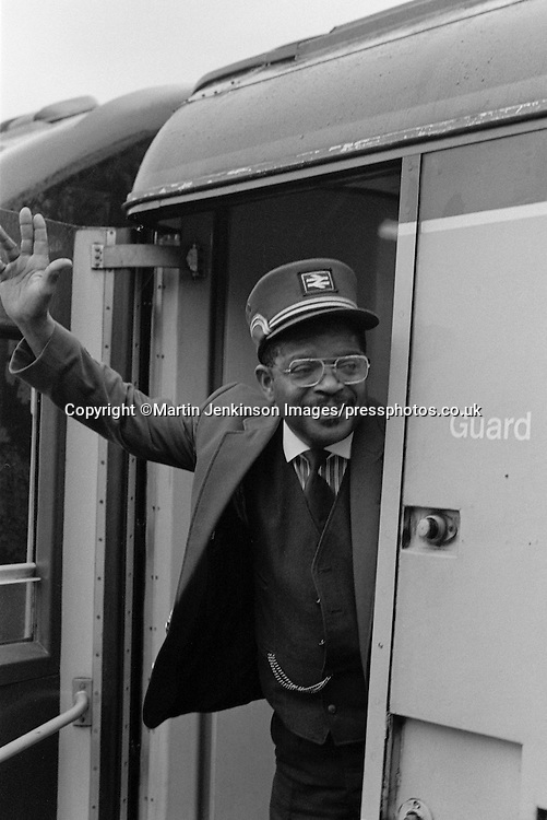 British Rail guard on train.