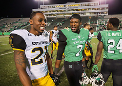 Nov 25, 2017; Huntington, WV, USA; Marshall Thundering Herd defensive back Jaylon McClain-Sapp (7) talks with Southern Miss Golden Eagles defensive back Rachuan Mitchell (21) after the game at Joan C. Edwards Stadium. Mandatory Credit: Ben Queen-USA TODAY Sports