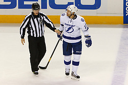 Dec 21, 2011; San Jose, CA, USA; Tampa Bay Lightning center Dominic Moore (19) is escorted to the penalty box by NHL linesman Vaughan Rody (73) during the first period against the San Jose Sharks at HP Pavilion. Mandatory Credit: Jason O. Watson-US PRESSWIRE