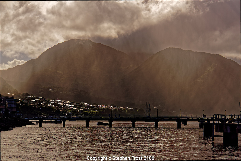 A coastal scene on the Caribbean Island of Dominica; the sun's rays breaking through the early morning mist.