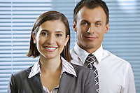 Portrait of smiling businessman and woman in office