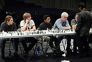 Middletown, NY - Chess champion Deepak Aaron, right, plays 32 opponents in an exhibition at Middletown High School on Saturday, Jan. 30, 2010. Aaron recently won the North American Youth Chess Championship in the Under-16 category. He is a master candidate.