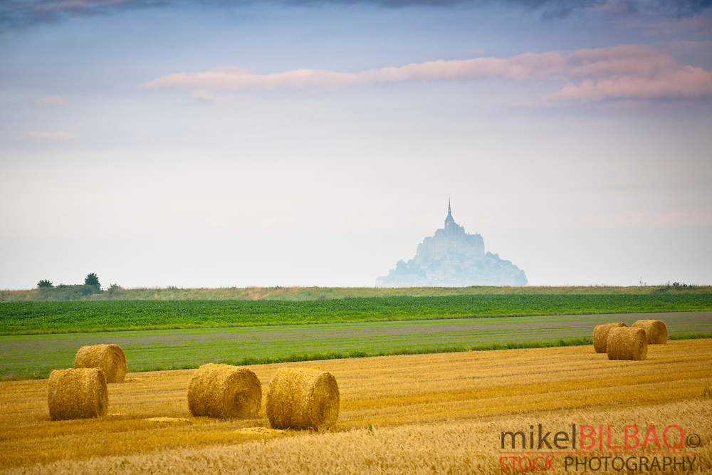 St Michael&acute;s Mount and farm land with wheat bales.<br /> Normandie, Normandy, France, Europe