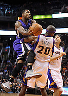 Dec. 17, 2012; Phoenix, AZ, USA; Sacramento Kings forward Thomas Robinson (0) drives the ball during the game against the Phoenix Suns center Jermaine O'Neal (20) in the first half at US Airways Center. Mandatory Credit: Jennifer Stewart-USA TODAY Sports.