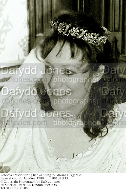 Rebecca Fraser during her wedding to Edward Fitzgerald. Farm St church. London. 1988. film 881031f33<br />© Copyright Photograph by Dafydd Jones<br />66 Stockwell Park Rd. London SW9 0DA<br />Tel 0171 733 0108