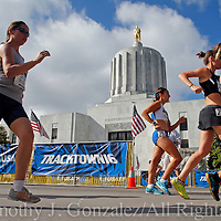 Racers take part in the womens Olympic Trials 20K race walk in Salem, Ore., on Thursday  June 30, 2016.