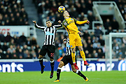 Solly March (#20) of Brighton & Hove Albion wins a header against DeAndre Yedlin (#22) of Newcastle United during the Premier League match between Newcastle United and Brighton and Hove Albion at St. James's Park, Newcastle, England on 30 December 2017. Photo by Craig Doyle.