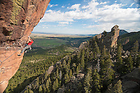 Ian Cavanaugh climbing Maiden Voyage 5.12b on the West face of the Maiden.