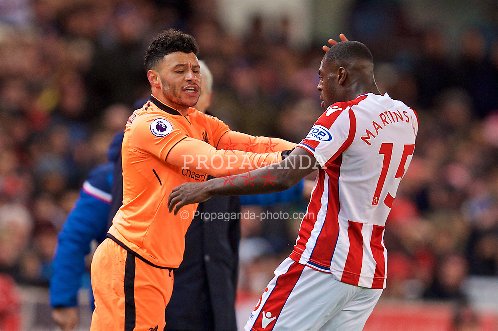 STOKE-ON-TRENT, ENGLAND - Wednesday, November 29, 2017: Liverpool's Alex Oxlade-Chamberlain clashes with Stoke City's Bruno Martins Indi during the FA Premier League match between Stoke City and Liverpool at the  Bet365 Stadium. (Pic by David Rawcliffe/Propaganda)
