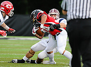 North Squad's  Sal Lupoli, from Chelmsford High School, tackles South Squad's Jeremy Soule, from Middleboro High School, during the Shriner's All-Star Football Classic at Bentley University in Waltham, June 22, 2018.   [Wicked Local Photo/James Jesson]